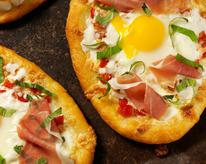 Pizza Margherita with Prosciutto di Parma and Poached Egg