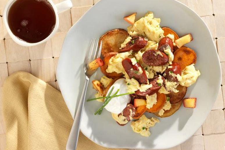Scrambled Eggs with Bison Hickory Smoked Sausage on Roasted Potatoes, Yams, and