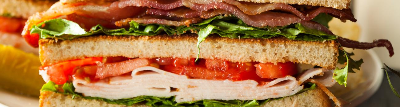 Not a picture of a chicken and lettuce under bacon sandwich, as that  meaning requires a specific arrangement of ingredients