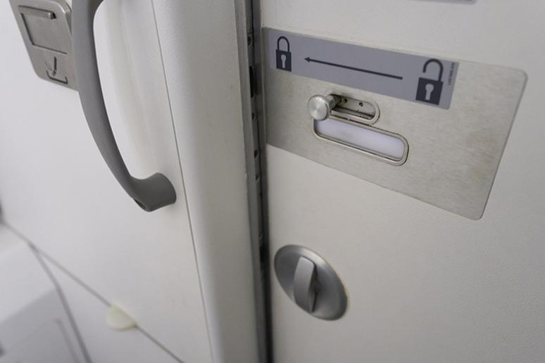 Avoid touching surfaces on an airplane