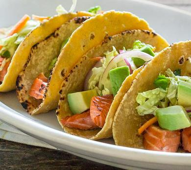 For the Grilled Salmon Tacos With Avocado Cabbage Carrot Slaw