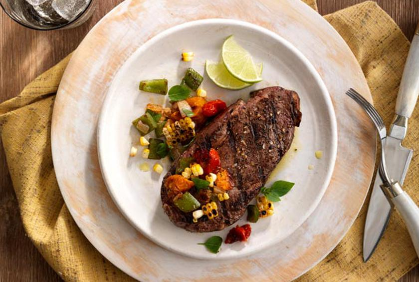 Bison Ribeye Steaks with Pan Seared Tomato and Corn Salsa