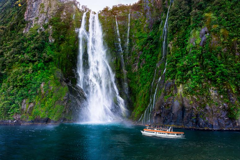 Take a boat ride under a waterfall in Milford Sound