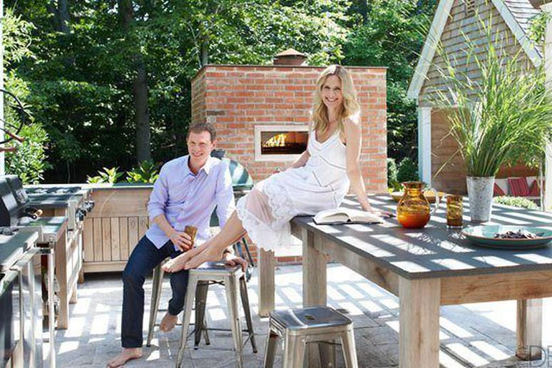 Bobby Flay and Stephanie March in their outdoor kitchen