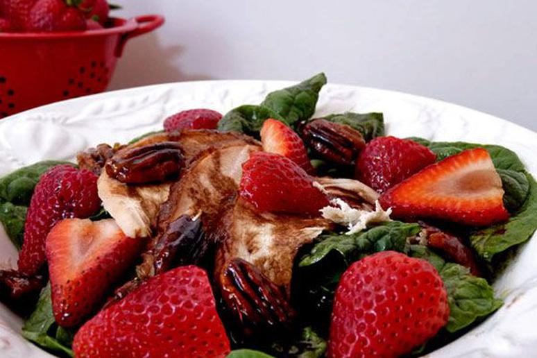 Roasted Chicken on Spinach with Strawberries, Caramelized Pecans, and Balsamic D