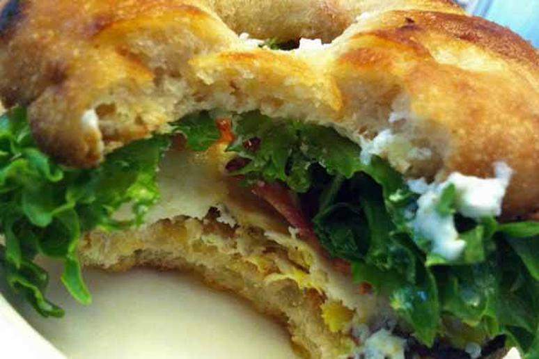 Sunnied Egg Bialy Sandwich with Bacon, Arugula, Goat Cheese, and Balsamic Glaze
