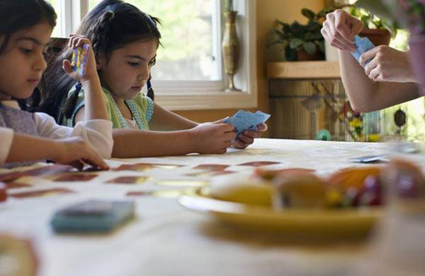 Image result for kids playing board games at christmas party formal attire
