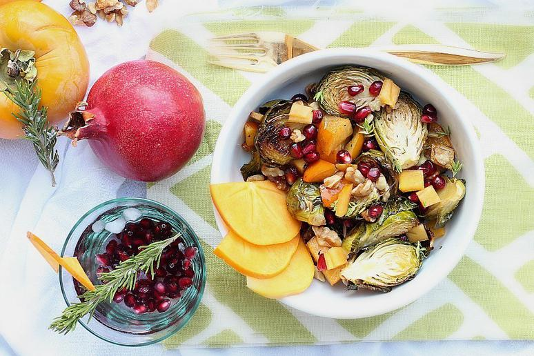 Pomegranate Salad With Roasted Persimmon, Brussels Sprouts, and Maple Dressing