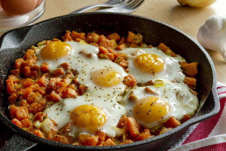 Sweet Potato Hash With Caramelized Onions, Sausage, and Eggs