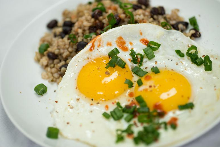 Fried Eggs With Wild Rice and Sautéed Kale
