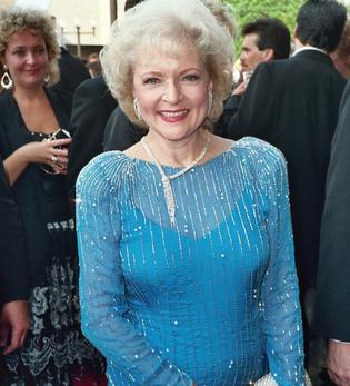 Betty White says she lives on hot dogs, French fries, candy – and vodka with lemon.