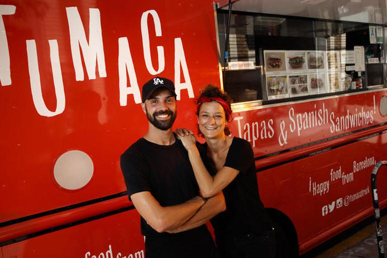 Husband and wife Victor and Sybil Roquin, with their Tumaca food truck.