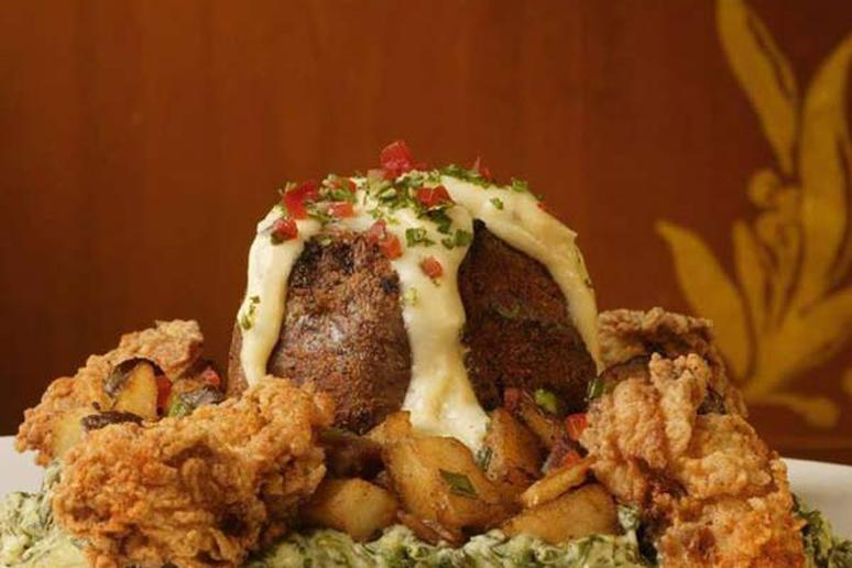 The 6-ounce house filet is topped with fried oysters and béarnaise sauce.