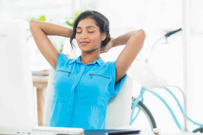 woman thinking mindfully at her desk