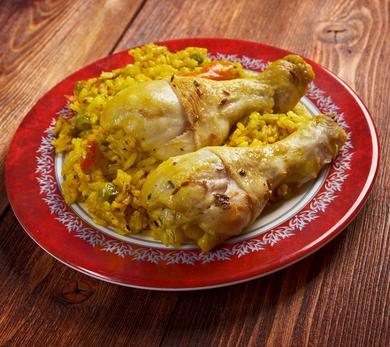 Arroz con pollo and salad