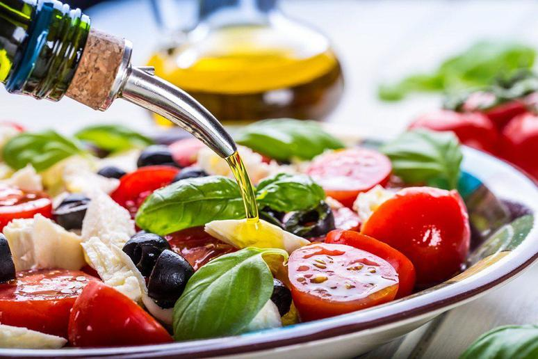 Dress Salads, Seafood, and Vegetables With Extra Virgin Olive Oil