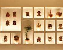 Authentic Greek pottery and ceramics dating back decades line the walls at Kyma
