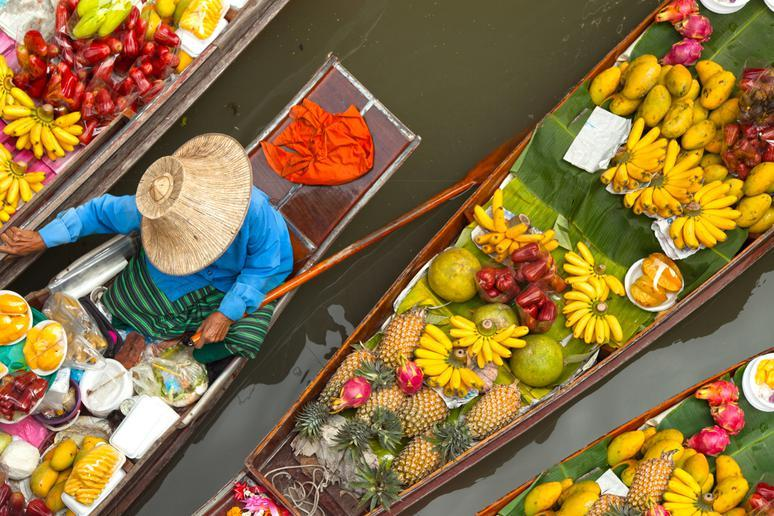 Shop at the floating markets in Bangkok