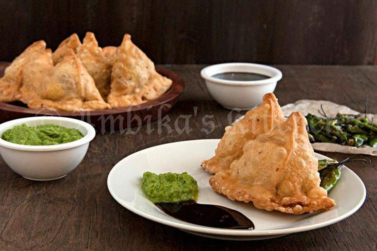 Samosa -  Savory Indian pies that need no introduction. Potato filled samosas, with a tangy tamarind chutney and a green chutney