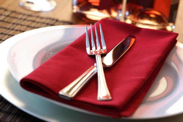 Place setting with red napkin