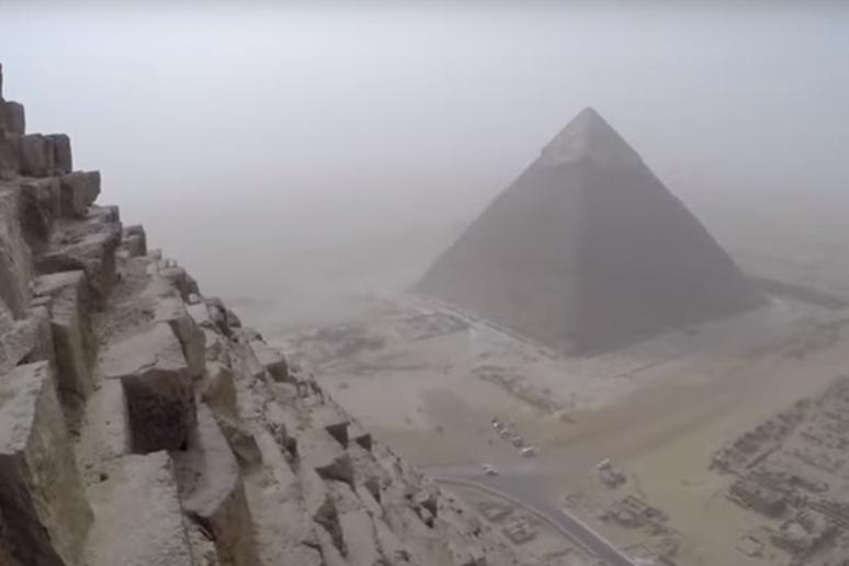 Climbing to the top of the Cheops pyramid in Egypt
